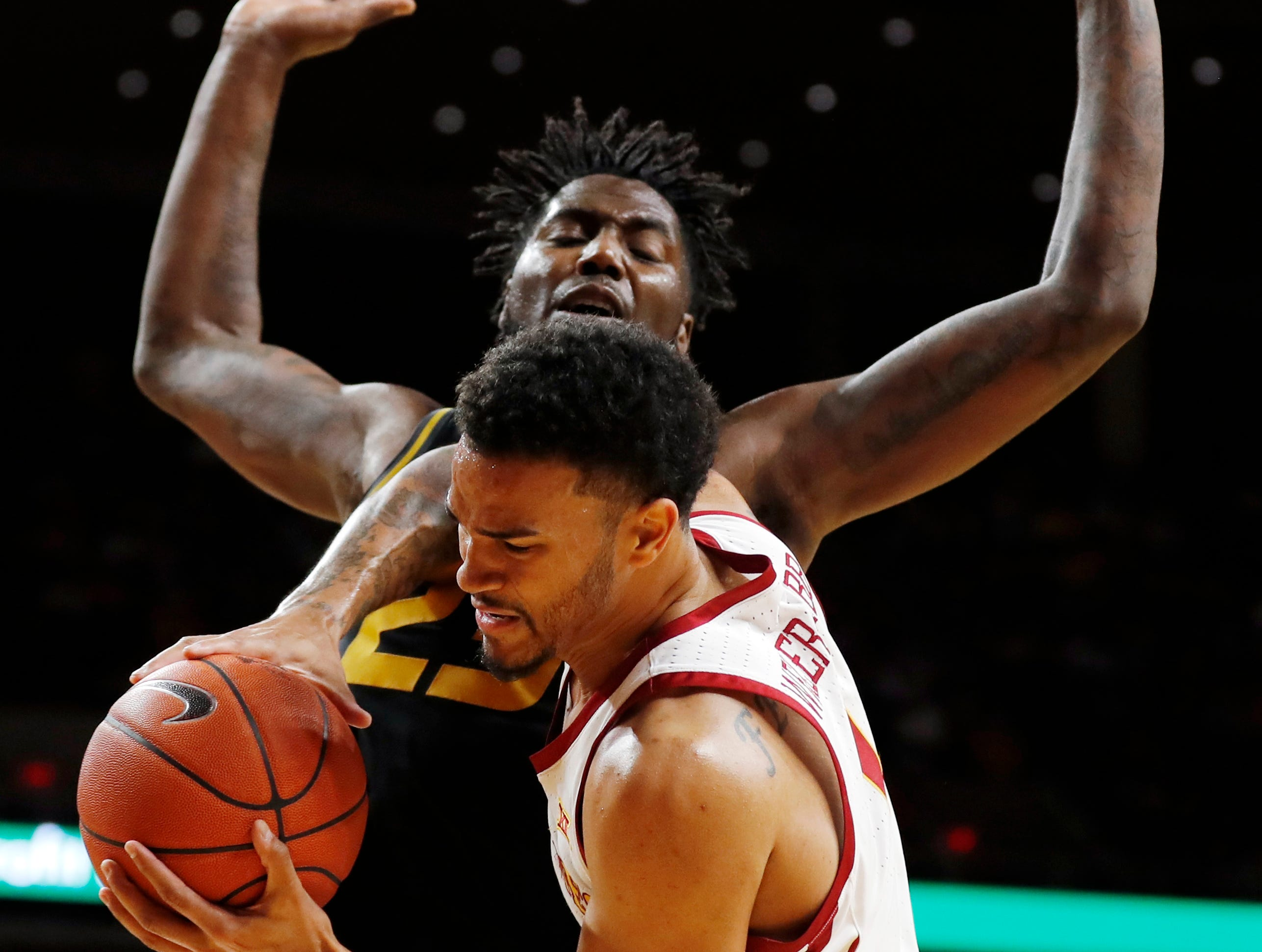 Iowa State guard Nick Weiler-Babb grabs a rebound in front of Missouri forward Jeremiah Tilmon, rear, during the second half of an NCAA college basketball game, Friday, Nov. 9, 2018, in Ames, Iowa. Iowa State won 76-59.