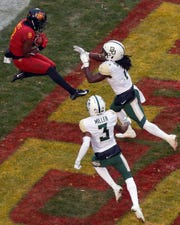 Iowa State wide receiver Deshaunte Jones (8) leaps to catch a touchdown pass over Baylor safeties Verkedric Vaughns, right, and Chris Miller, bottom, during the first half of an NCAA college football game, Saturday, Nov. 10, 2018, in Ames.