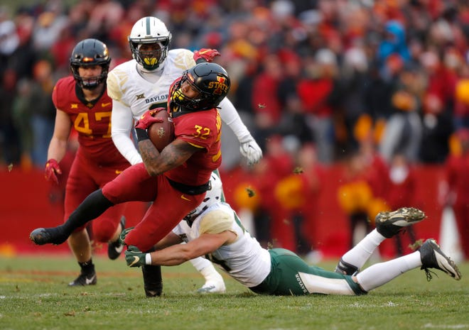 Iowa State running back David Montgomery, front left, runs the ball as he is tackled by Baylor linebacker Clay Johnston, right, during the first half of an NCAA college football game, Saturday, Nov. 10, 2018, in Ames.