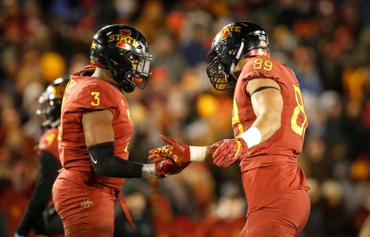 Iowa State's JaQuan Bailey, left, and Matt Leo celebrate after making a defensive stop against Baylor in the fourth quarter at Jack Trice Stadium in Ames on Saturday, Nov. 10, 2018.
