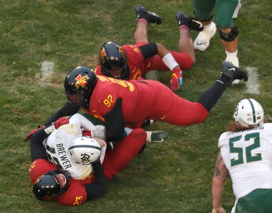 Iowa State defensive lineman Jamahl Johnson, top, and Iowa State linebacker Mike Rose, bottom, sack Baylor quarterback Charlie Brewer, center, during the first half of an NCAA college football game, Saturday, Nov. 10, 2018, in Ames. (AP Photo/Matthew Putney)