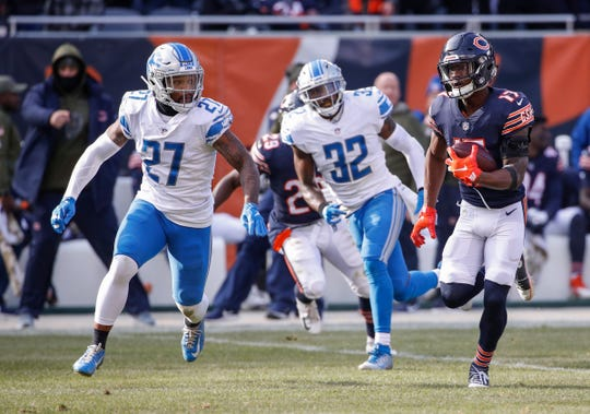 Chicago Bears receiver Anthony Miller runs with the ball against Detroit Lions safety Glover Quin during the second half at Soldier Field, Nov. 11, 2018.