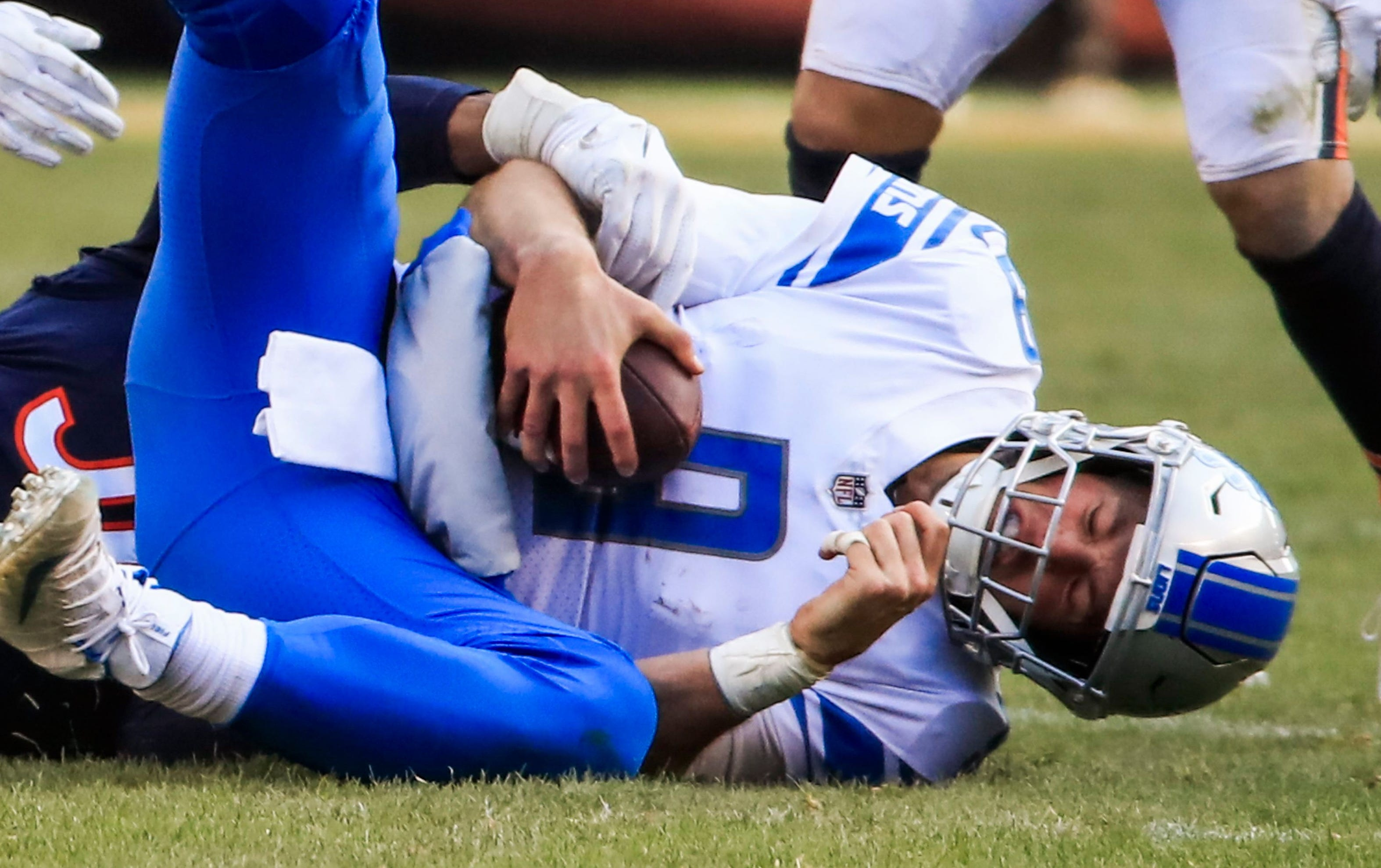 Detroit Lions quarterback Matthew Stafford is sacked by Chicago Bears linebacker Khalil Mack at Soldier Field in Chicago, Nov. 11, 2018.