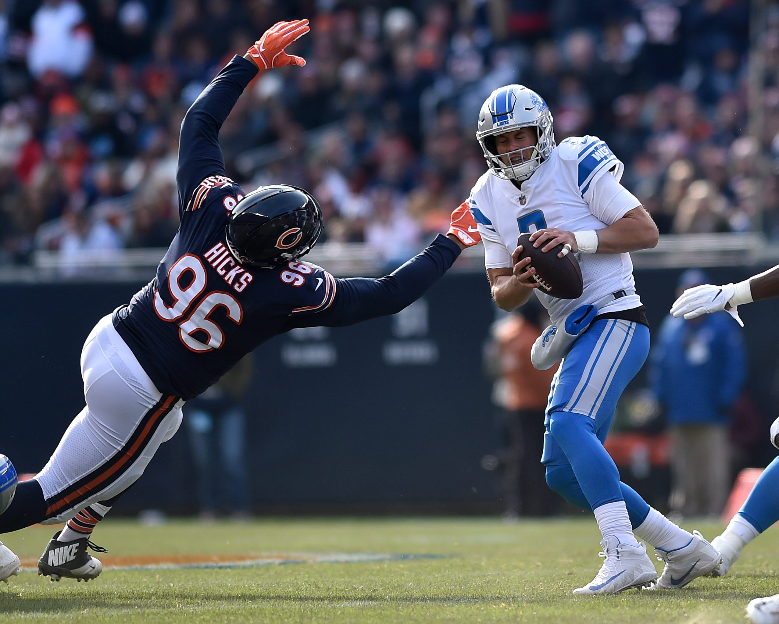 Bears defensive lineman Akiem Hicks lunges at Lions quarterback Matthew Stafford in the first quarter on Sunday, Nov. 11, 2018, in Chicago.