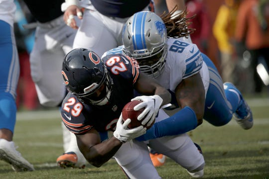 Bears running back Tarik Cohen dives into the end zone for a touchdown against Lions defensive tackle Damon Harrison during the first half on Sunday, Nov. 11, 2018, in Chicago.