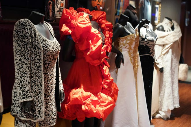 """Stage dresses and accessories worn by the eighteen time Grammy winning singer/songwriter Aretha Franklin are displayed Oct. 29, 2018, at the Hard Rock Cafe Times Square in New York,  part of Julien's Auctions two-day music extravaganza """"Icons & Idols: Rock-n-Roll."""" Franklin, one of the best-selling musical artists of all time, sold more than 75 million records worldwide."""