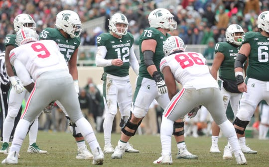 Michigan State's Rocky Lombardi runs the offense against Ohio State during the second half of the 26-6 loss to Ohio State on Saturday, Nov. 10, 2018, in East Lansing.