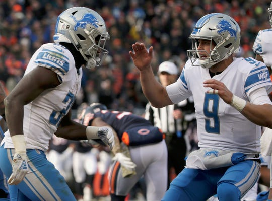 Lions running back Kerryon Johnson celebrates a touchdown with quarterback Matthew Stafford (9) during the first half on Sunday, Nov. 11, 2018, in Chicago.