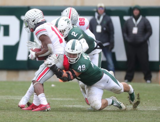 Michigan State's Kenny Willekes (48) and Justin Layne tackle Ohio State's K.J. Hill Jr. during the second half of the 26-6 loss to Ohio State on Saturday, Nov. 10, 2018, in East Lansing.