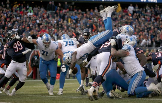 Lions running back Kerryon Johnson dives into the end zone for a touchdown during the first half Nov. 11, 2018, in Chicago.