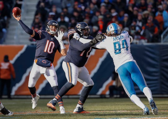 Detroit Lions defensive end Ziggy Ansah rushes against Chicago Bears tackle Charles Leno Jr., as quarterback Mitchell Trubisky passes during the second half at Soldier Field, Nov. 11, 2018.