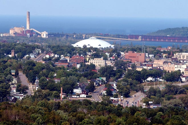 Caption:  An look at the town of Marquette taken from Mt. Marquette.  The white dome is called the Superior Dome where NMU plays football and the lake in the background belongs to Lake Superior. The Presque Isle Power Plant can be seen in the far left as well.