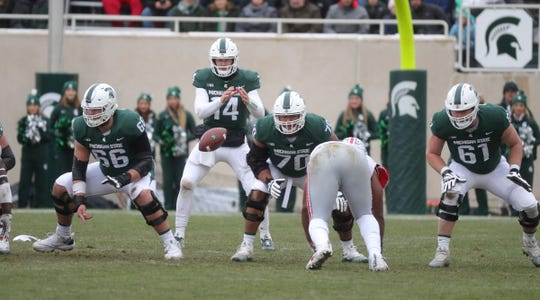 Michigan State's Brian Lewerke runs the offense during the first half of the 26-6 loss to Ohio State on Saturday, Nov. 10, 2018, in East Lansing.