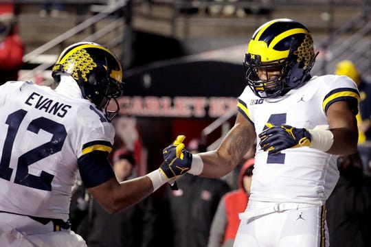 Michigan receiver Nico Collins, right, celebrates his touchdown with running back Chris Evans during the second half against Rutgers, Saturday, Nov. 10, 2018, in Piscataway, N.J.