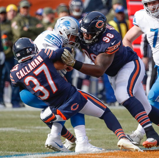 Bears cornerback Bryce Callahan and defensive tackle Bilal Nichols tackle Lions quarterback Matthew Stafford during the first half on Sunday, Nov. 11, 2018, in Chicago.