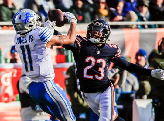 Chicago Bears cornerback Kyle Fuller breaks up a pass intended for Detroit Lions receiver Marvin Jones at Soldier Field in Chicago, Nov. 11, 2018.