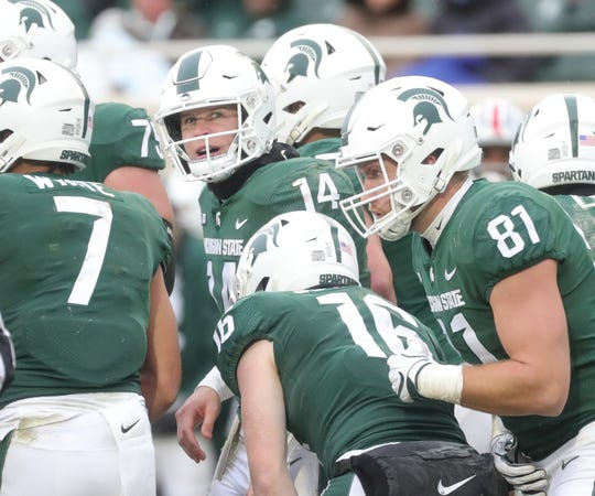Michigan State's Brian Lewerke calls a play after coming back into the game during the 26-6 loss to Ohio State on Saturday, Nov. 10, 2018, in East Lansing.