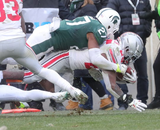 Michigan State's Khari Willis tackles Ohio State's Mike Weber Jr. during the second half of the 26-6 loss to Ohio State on Saturday, Nov. 10, 2018, in East Lansing.