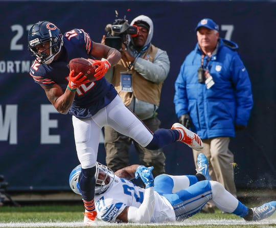 Bears wide receiver Allen Robinson (12) is tackled by Lions free safety Glover Quin during the first half on Sunday, Nov. 11, 2018, in Chicago.