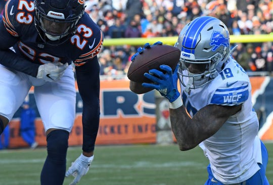 Detroit Lions receiver Kenny Golladay attempts to make a catch against Chicago Bears cornerback Kyle Fuller during the second half at Soldier Field, Nov. 11, 2018.