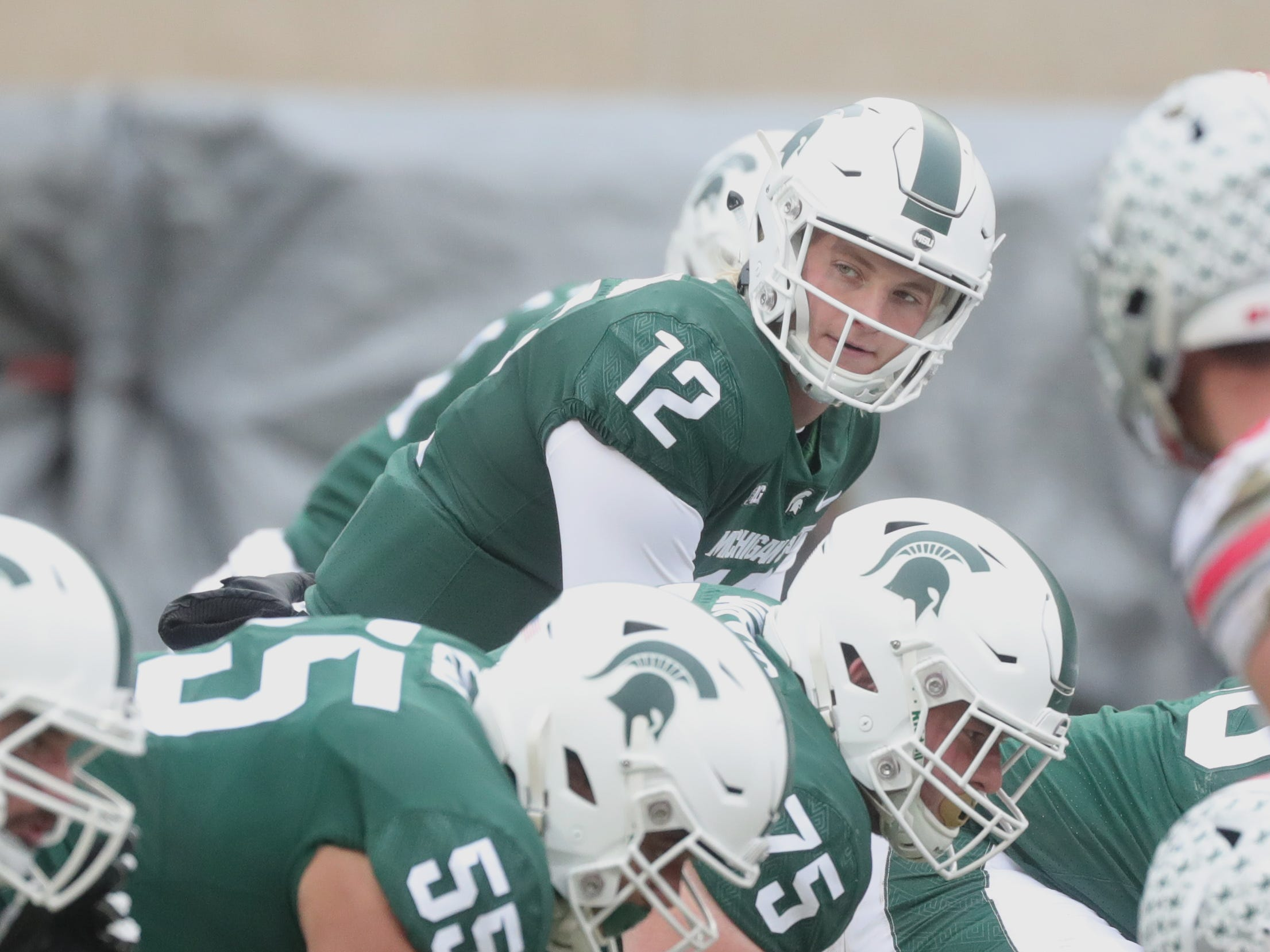 Michigan State's Rocky Lombardi runs the offense against Ohio State during the second half Saturday, Nov. 10, 2018 at Spartan Stadium, in East Lansing.