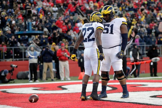 Michigan running back Karan Higdon celebrates his touchdown with offensive lineman Cesar Ruiz during the first half against Rutgers, Saturday, Nov. 10, 2018, in Piscataway, N.J.