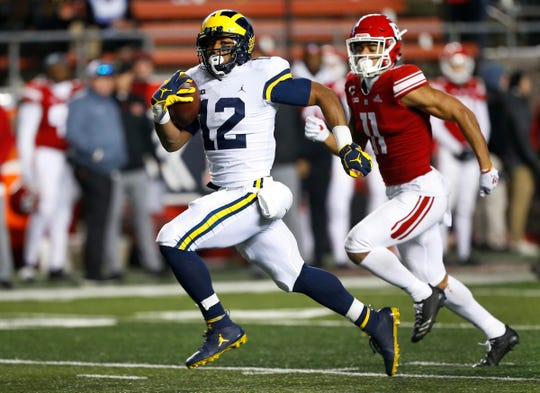 Michigan running back Chris Evans rushes for a touchdown against Rutgers during the second half Nov. 10, 2018 in Piscataway, N.J.