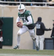 Michigan State's Brian Lewerke runs the ball against Ohio State during the first half of the 26-6 loss to Ohio State on Saturday, Nov. 10, 2018, in East Lansing.