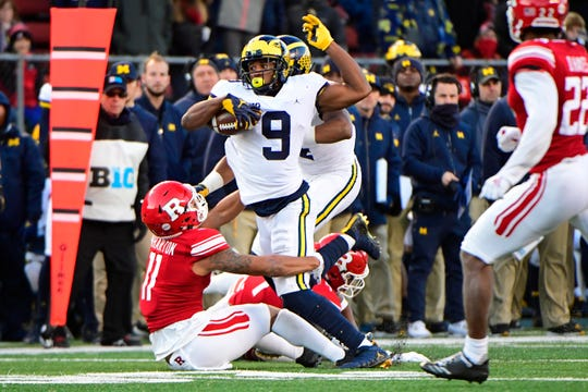 Michigan's Donovan Peoples-Jones is tackled by Rutgers' Isaiah Wharton during the second quarter Nov. 10, 2018 in Piscataway, N.J.