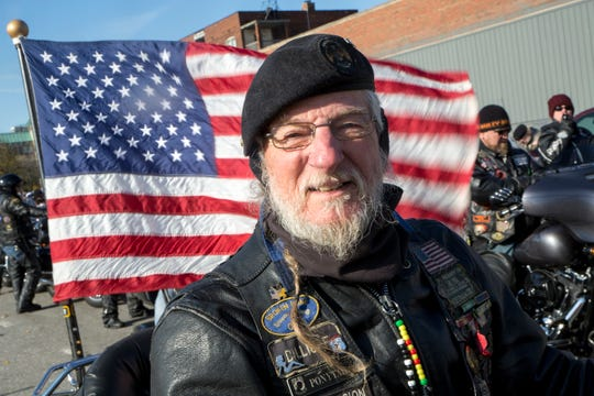 """Ponytail"" Mike Globke of the American Legion Riders prepares to join over 100 others riding to honor veterans during the Detroit Veterans Day Parade, on Ledyard St., in Detroit, Sunday, Nov. 11, 2018."