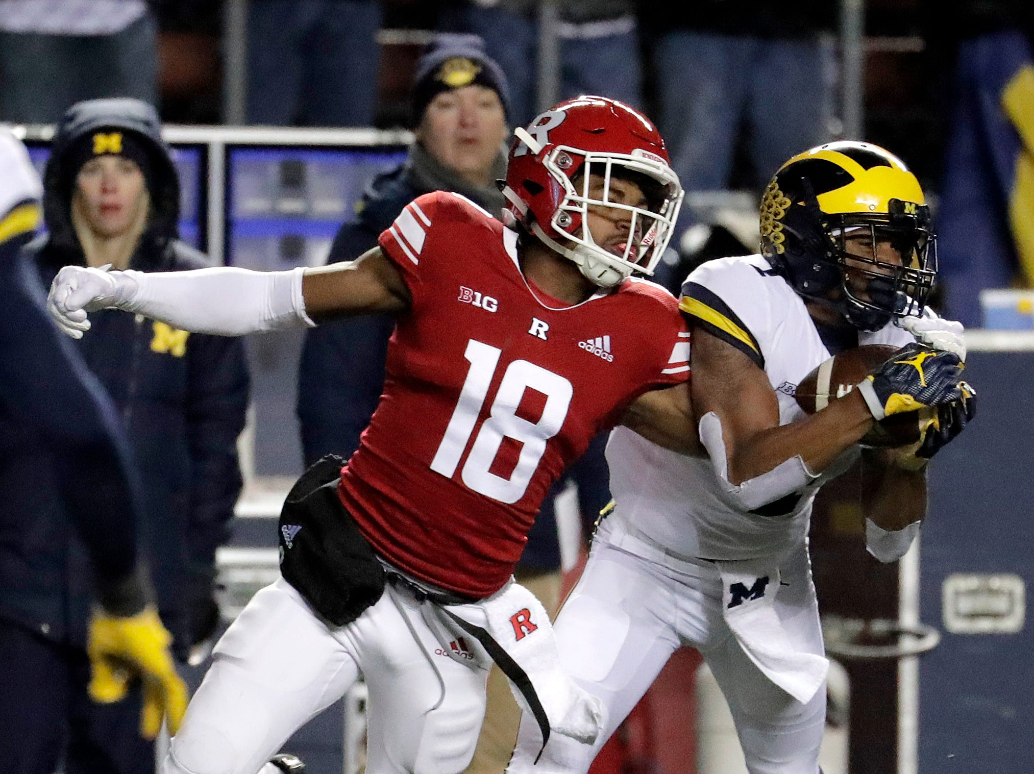 Michigan defensive back Ambry Thomas intercepts a pass from Rutgers quarterback Artur Sitkowski that was intended for wide receiver Bo Melton.