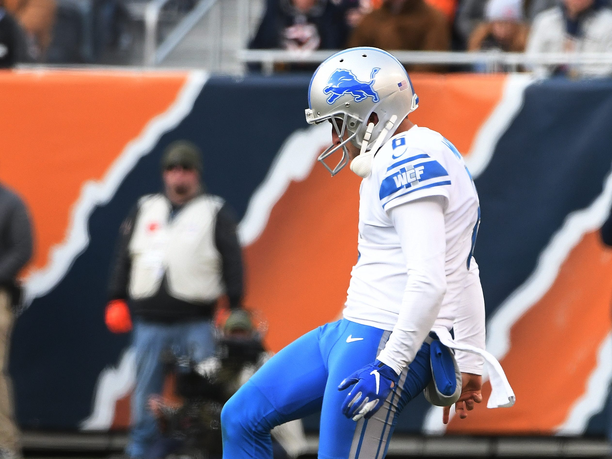 Lions punter Sam Martin kicks an onside kick that Detroit's Nick Bellore recovers in the fourth quarter.