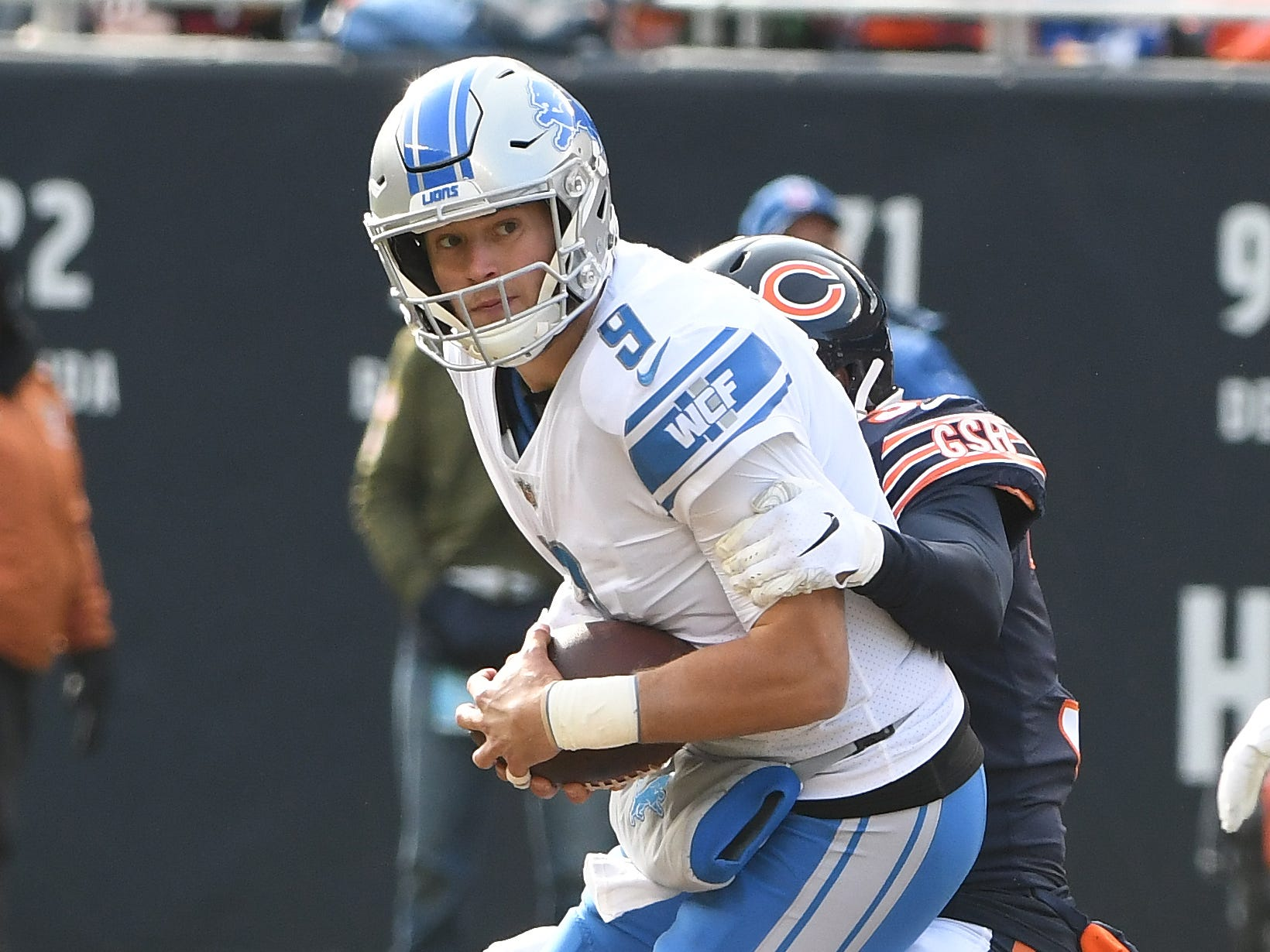 Lions quarterback Matthew Stafford is sacked by Bears' Bryce Callahn in the fist quarter.