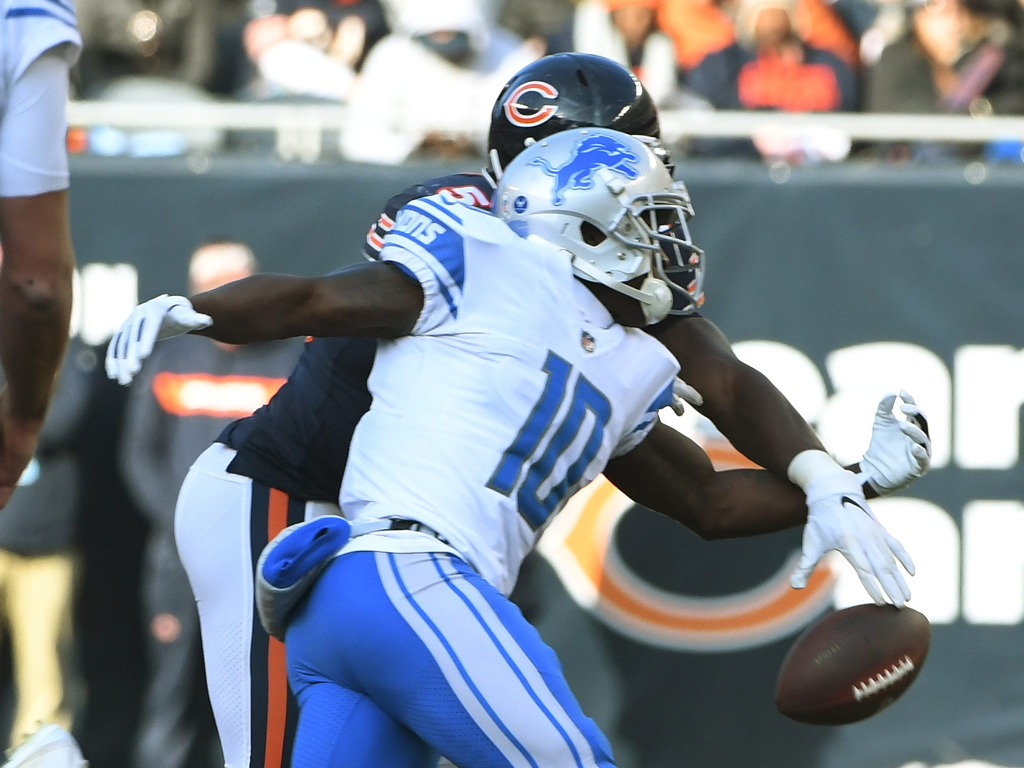 Lions rookie wide receiver Brandon Powell can't pull in a reception with Bears' Roquan Smith defending in the third quarter.