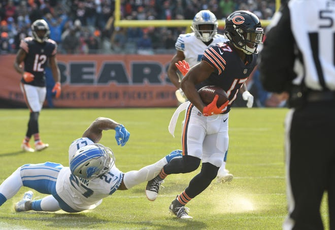 Bears' Anthony Miller throws off Lions'  Glover Quin and goes into the end zone for a touchdown in the second quarter.