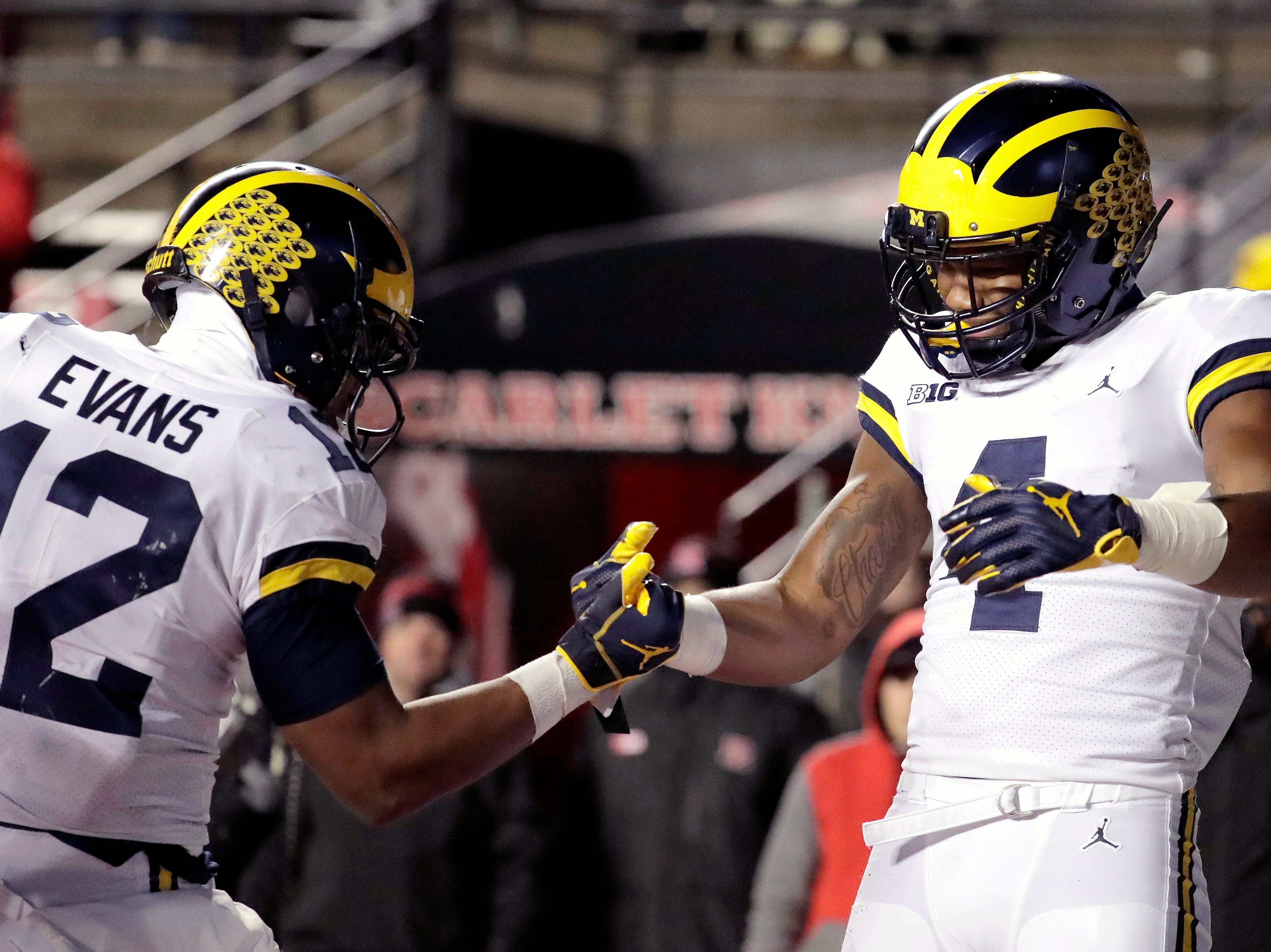 Michigan wide receiver Nico Collins, right, celebrates his touchdown catch with running back Chris Evans.