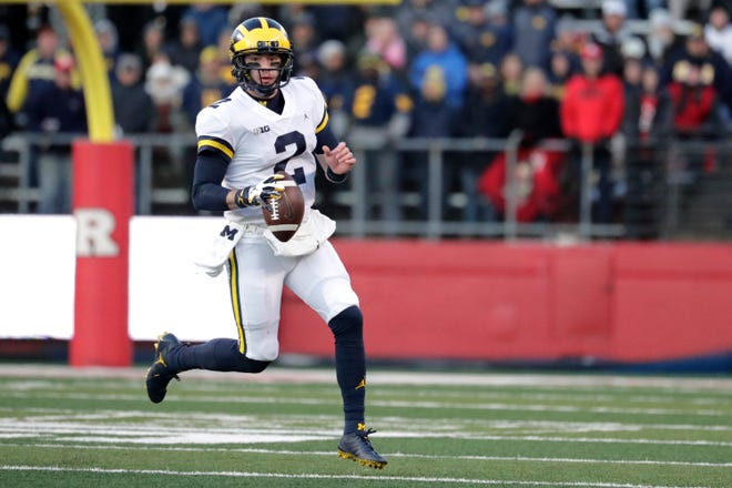 Michigan quarterback Shea Patterson looks to pass against Rutgers.