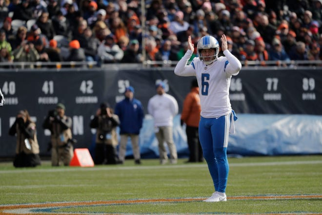 Detroit Lions punter Sam Martin gestures before taking a snap during the first half against the Chicago Bears.