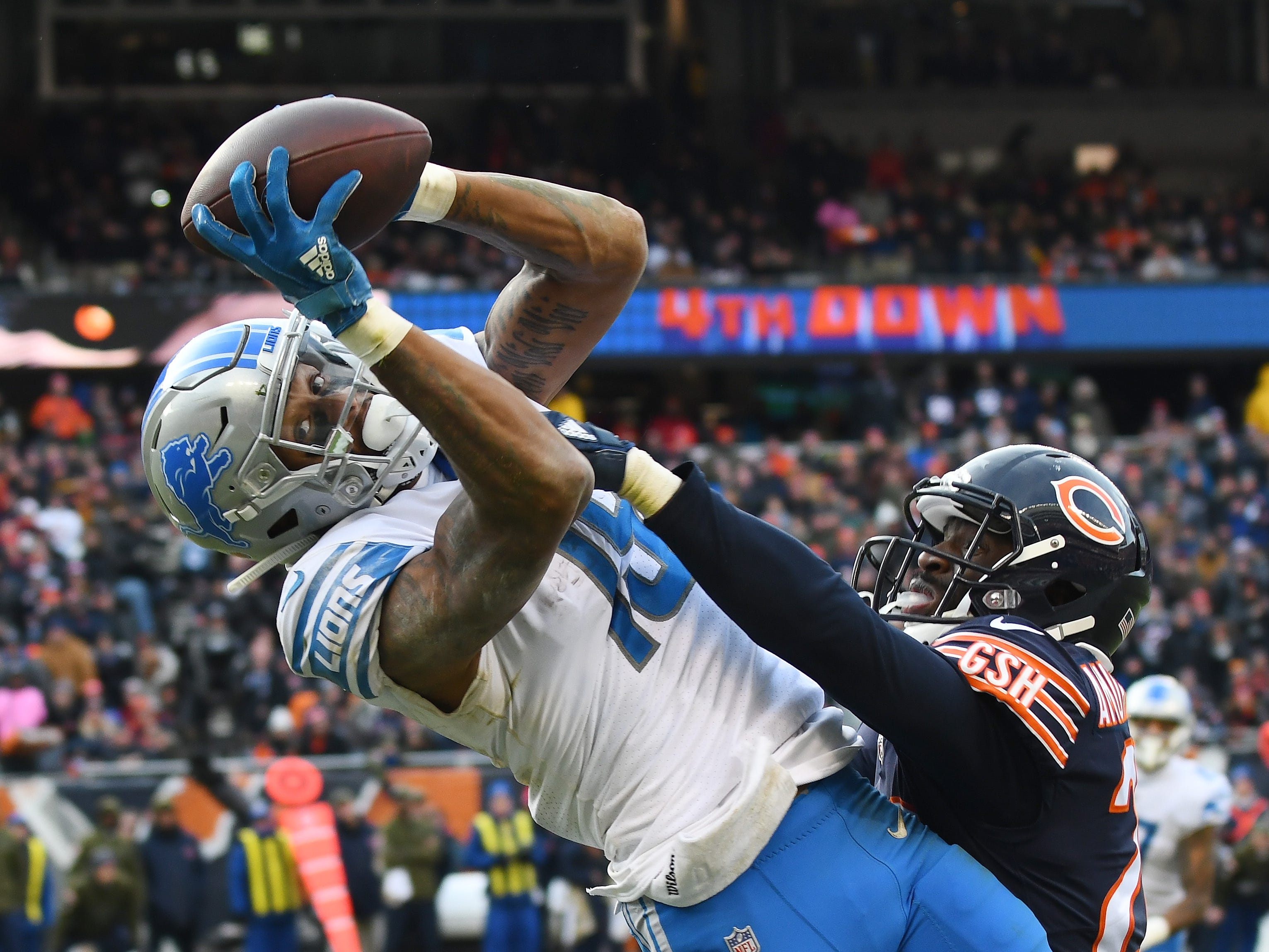 Lions wide receiver Kenny Golladay pulls in a reception along the sidelines over Chicagos' Prince Amukamara late in the fourth quarter.