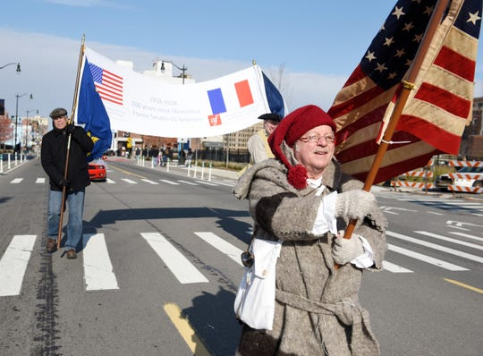David Martin of the French Instittute of Michigan marches during the parade.