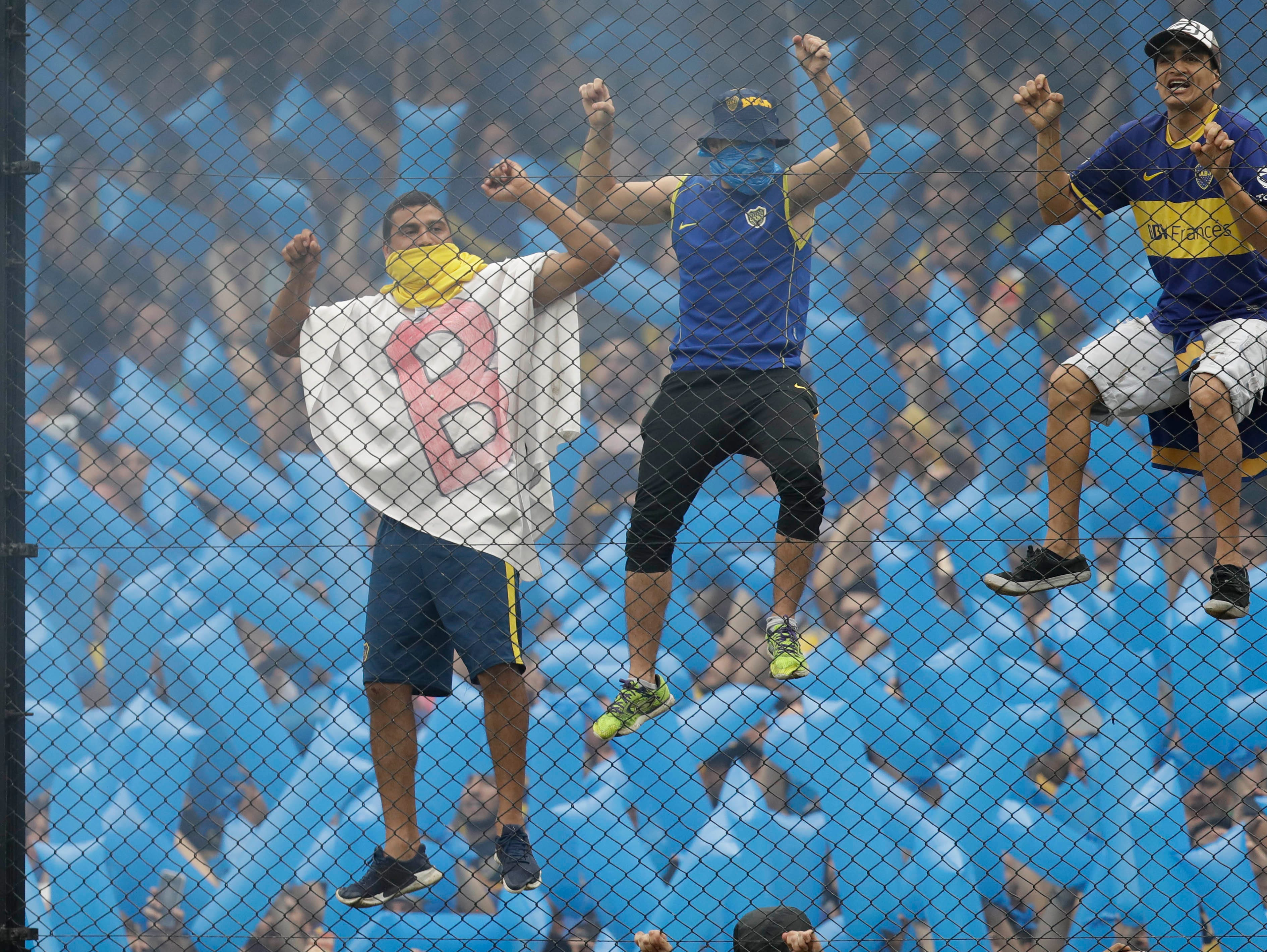 Fans of Argentina's Boca Juniors cheer during a Copa Libertadores first leg final soccer match against Argentina's River Plate in Buenos AIres, Argentina, Sunday, Nov. 11, 2018.