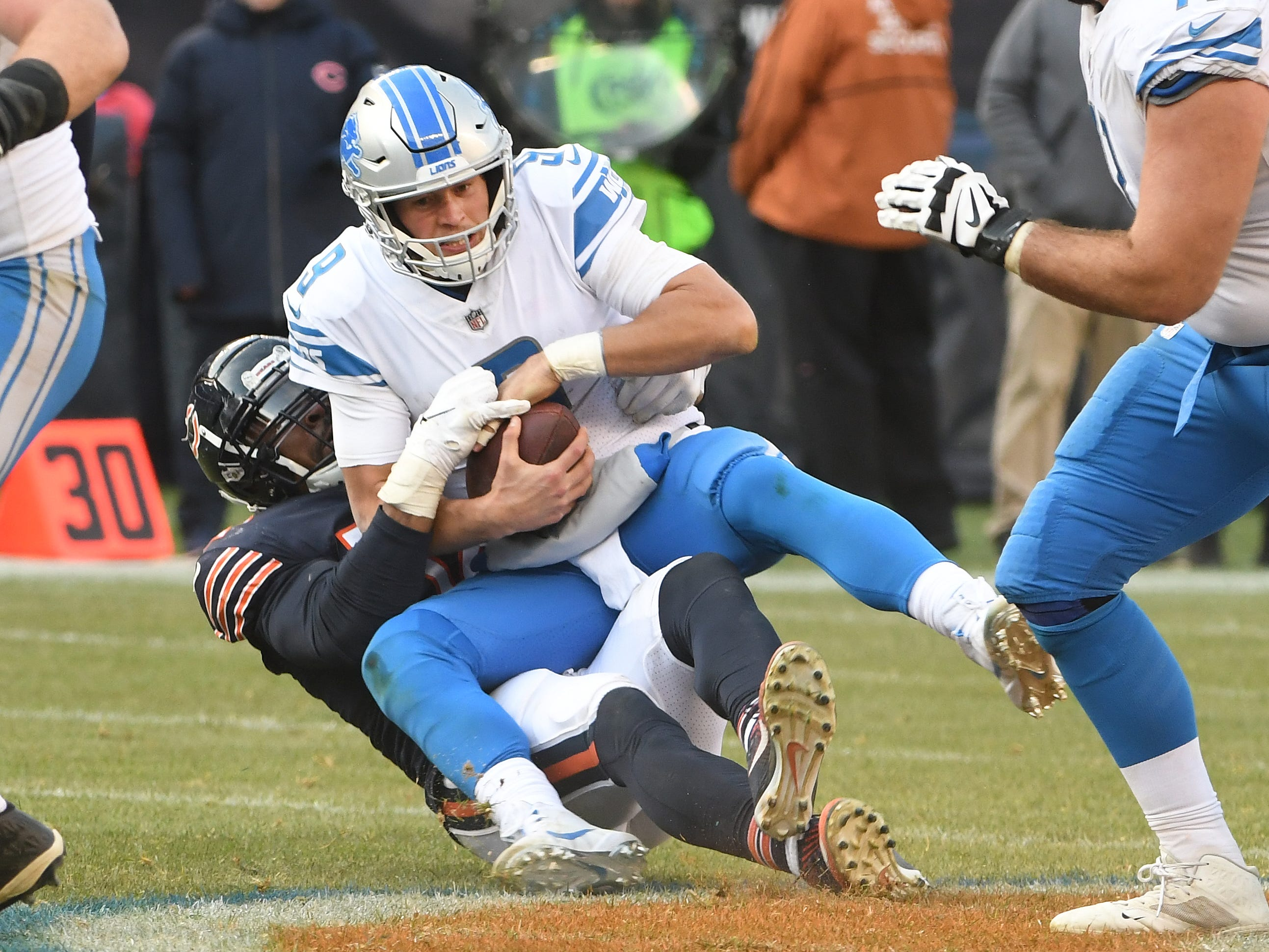 Lions quarterback Matthew Stafford is sacked by Bears' Khalil Mack in the fourth quarter.