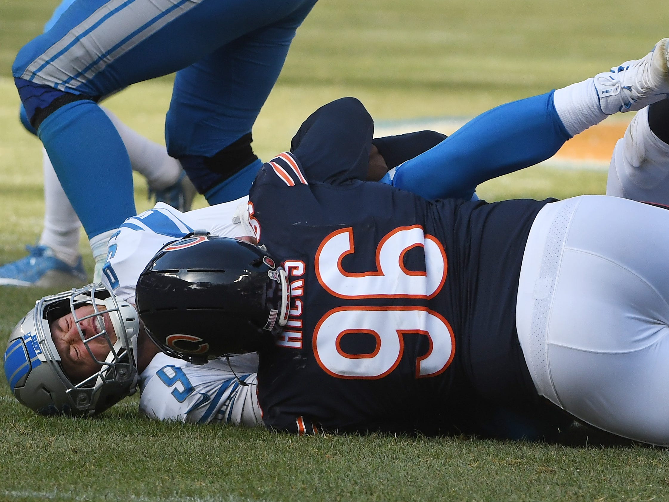 Lions quarterback Matthew Stafford is taken down to the ground, sacked by Bears' Akiem Hicks in the third quarter.