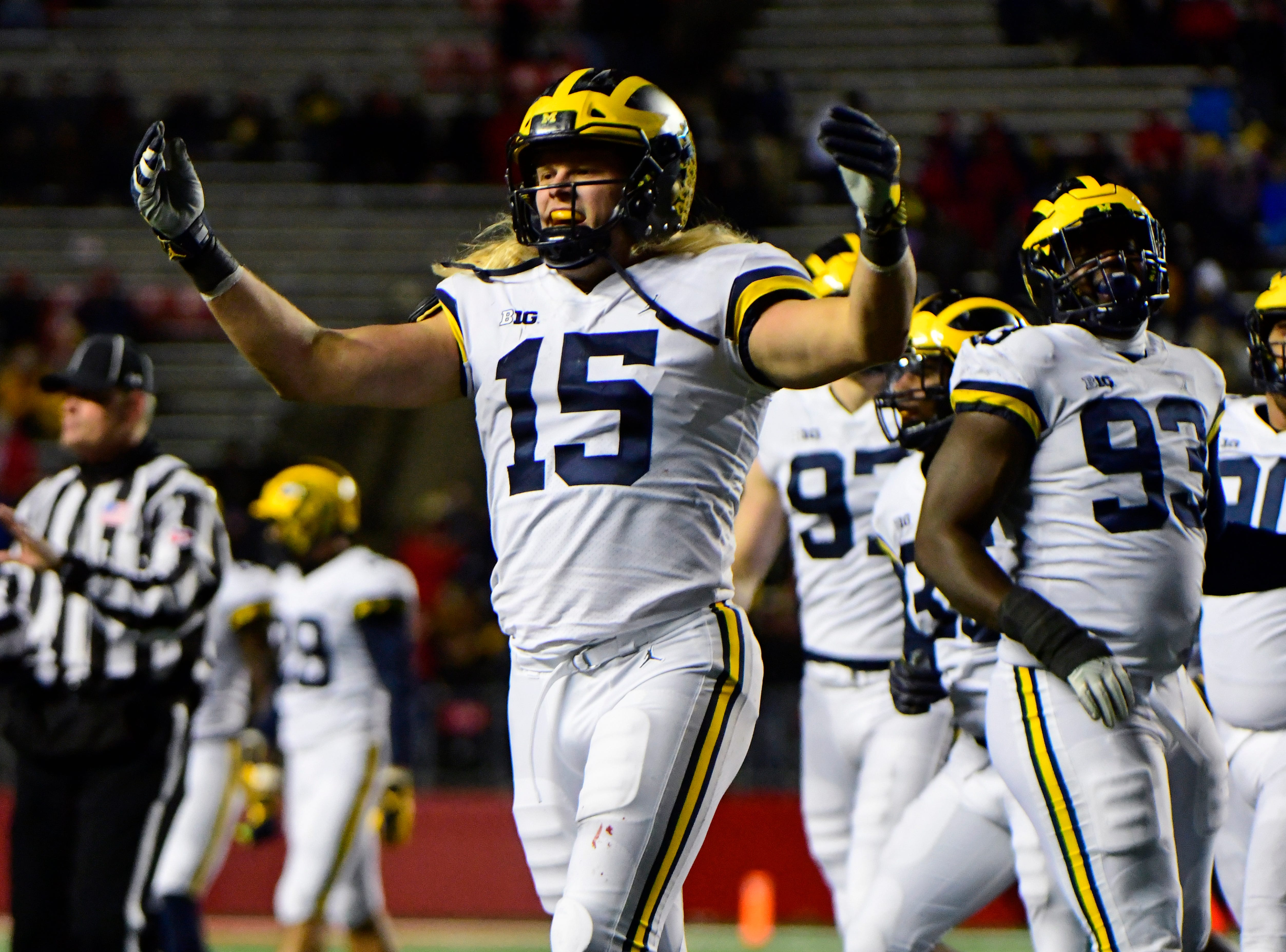 Chase Winovich pumps up the Michigan fans in the crowd.