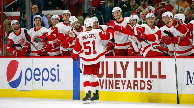 Detroit Red Wings teammates high-five Frans Nielsen after he scored in the shootout on Saturday night.