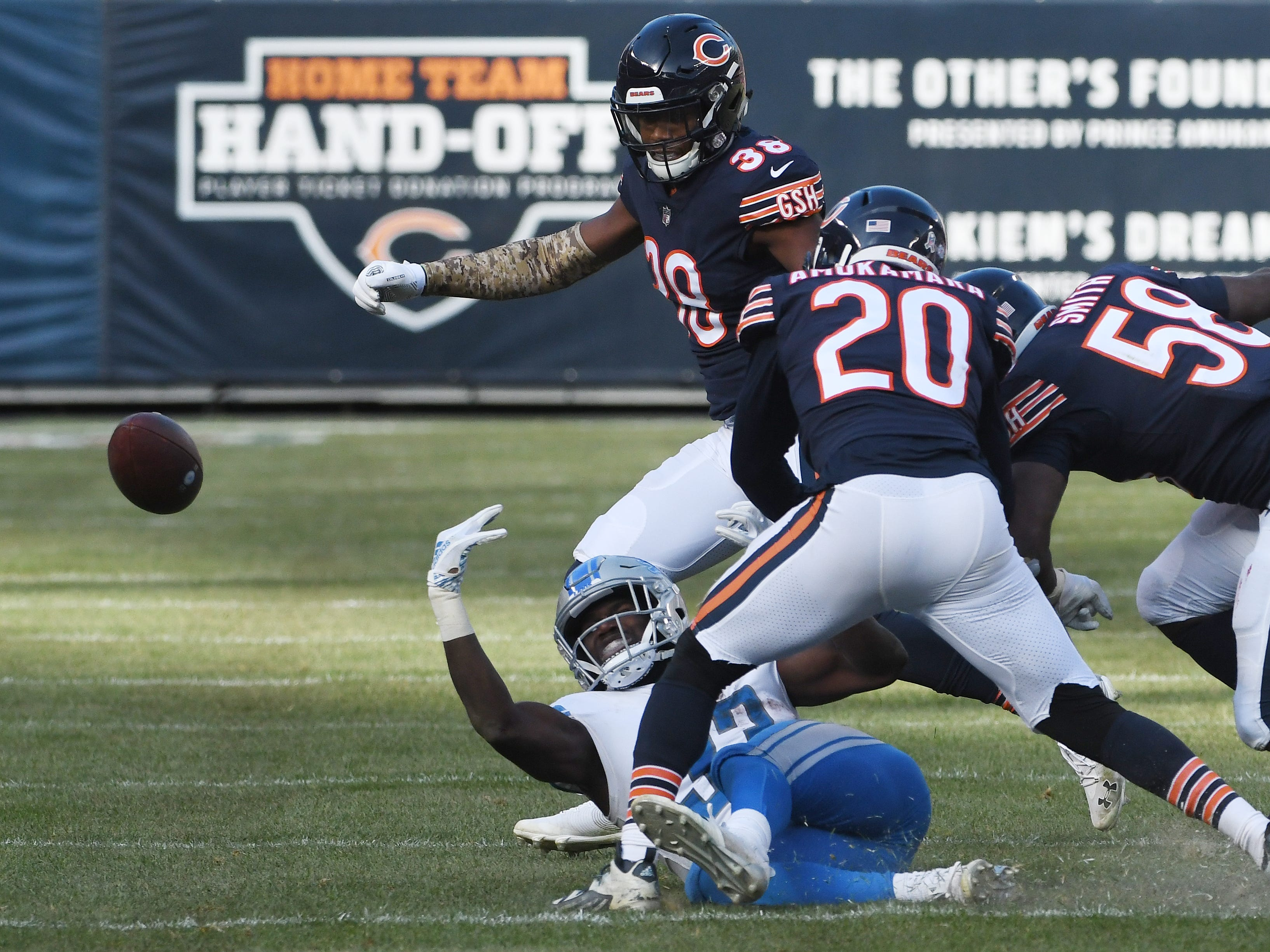 Lions running back Kerryon Johnson loses the ball when hit by Bears' Prince Amukamara, with Chicago's Adrian Amos Jr. recovering, in the third quarter.
