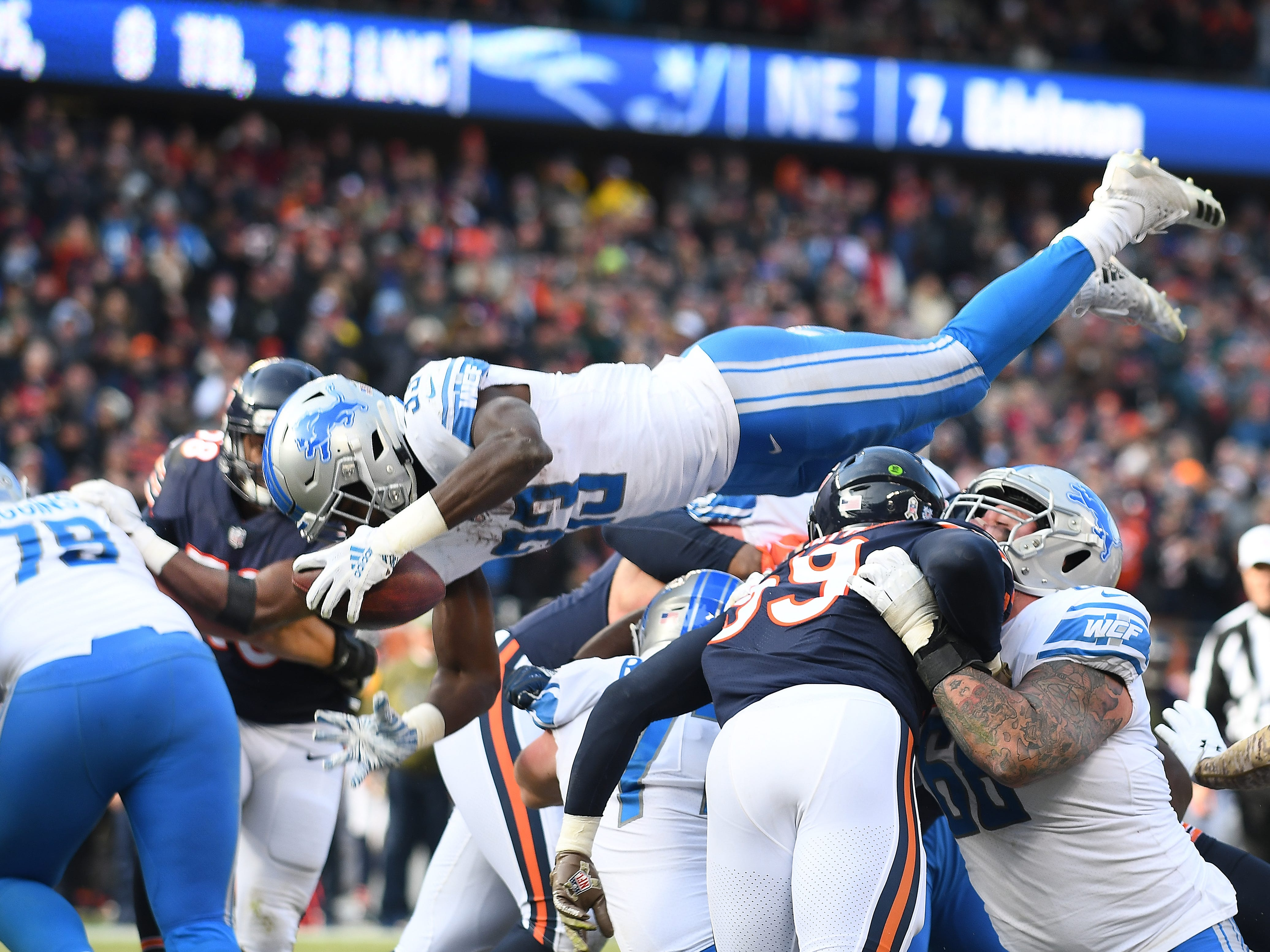 Lions running back Kerryon Johnson goes over the top for a touchdown, the only Detroit score of the 1st half, near the end of the second quarter during a game against thje Chicago Bears at Soldier Field in Chicago, Illinois on November 11, 2018.  Detroit lost to Chicago 34-22.
