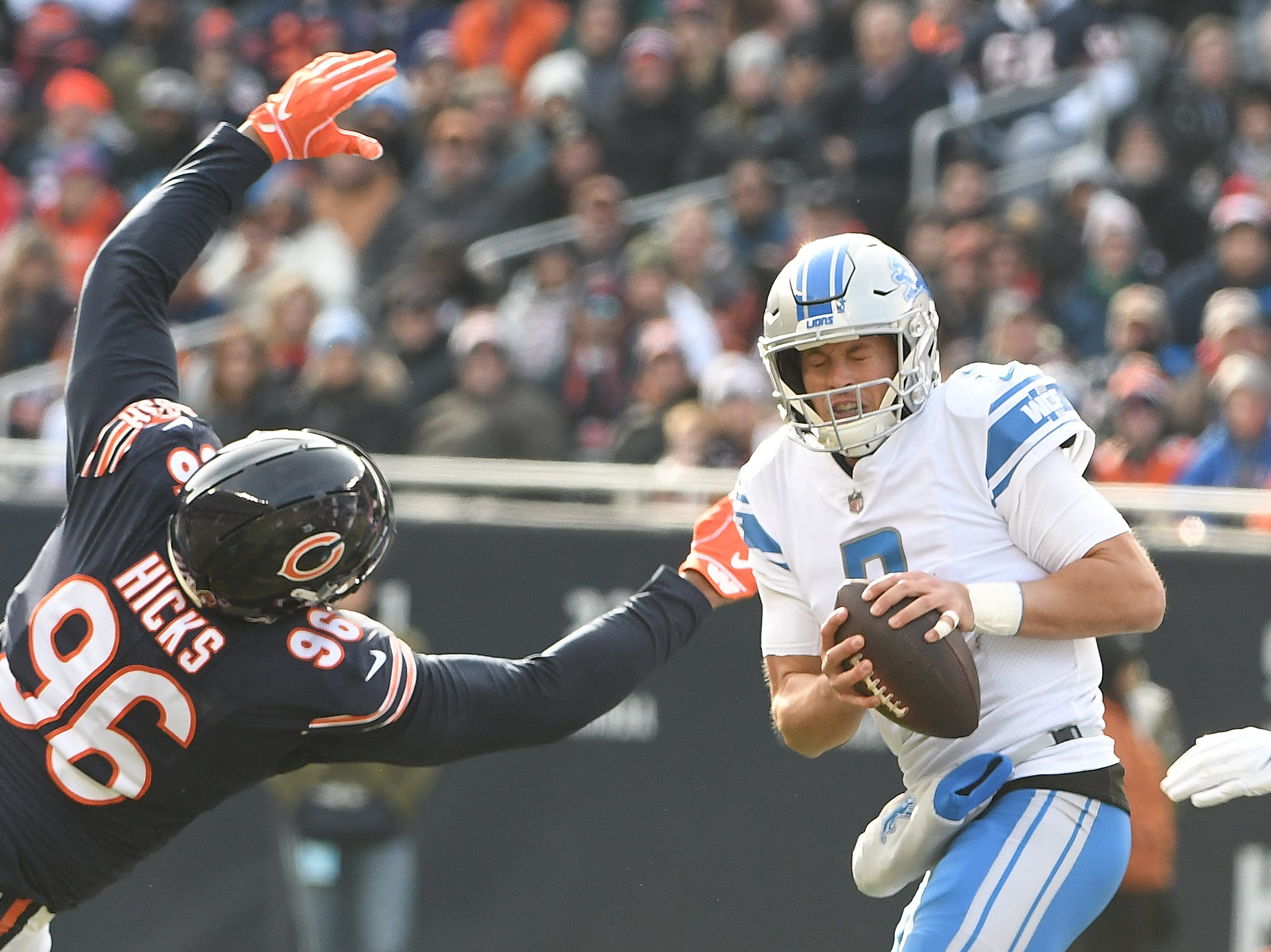 The hits are coming as Lions quarterback Matthew Stafford braces for a sack by Bears' Akiem Hicks and Roquan Smith, not shown, in the fist quarter.