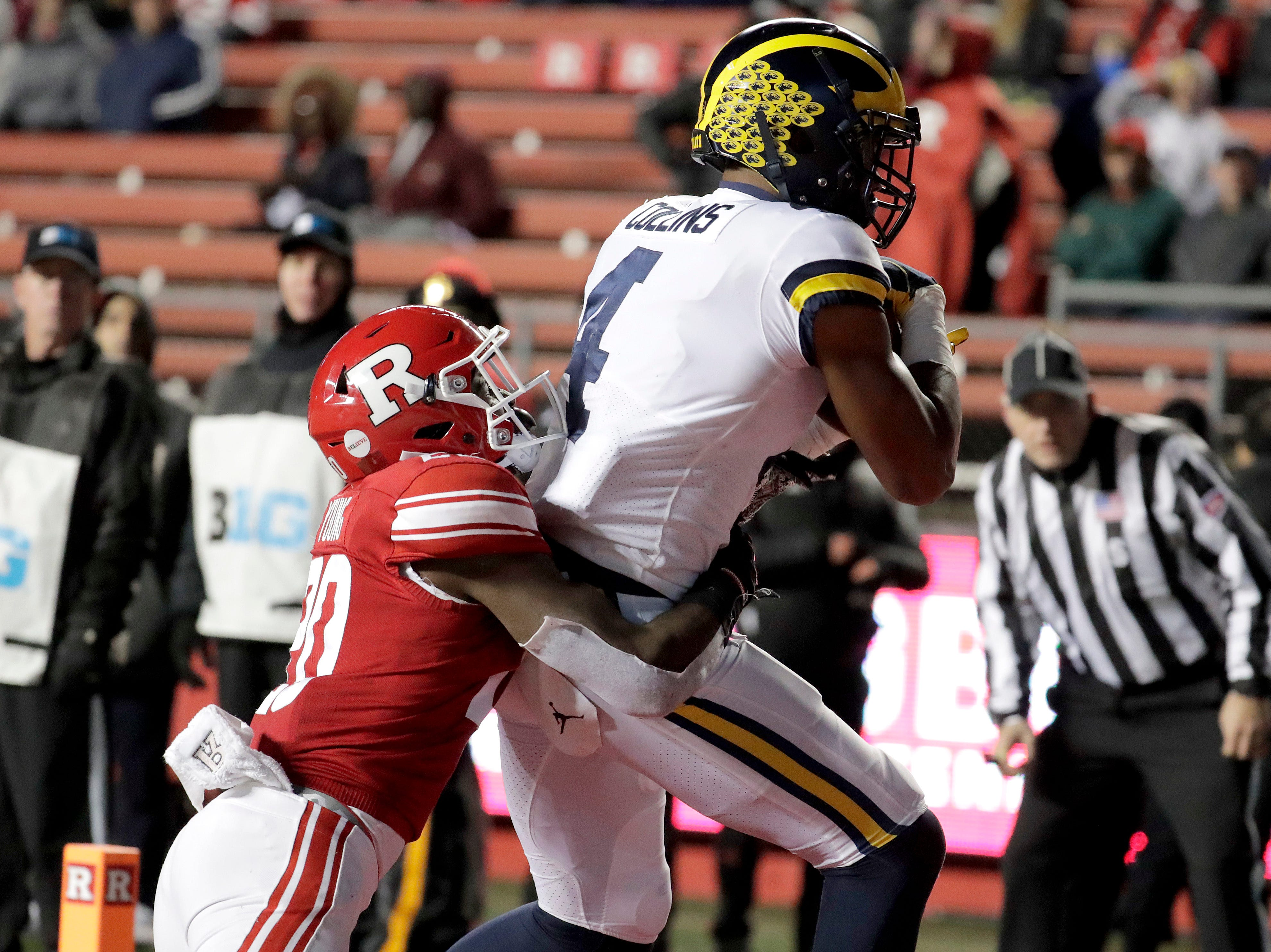 Michigan wide receiver Nico Collins, right, pulls in a touchdown catch on a pass from quarterback Shea Patterson as Rutgers defensive back Avery Young (20) tries to stop him.
