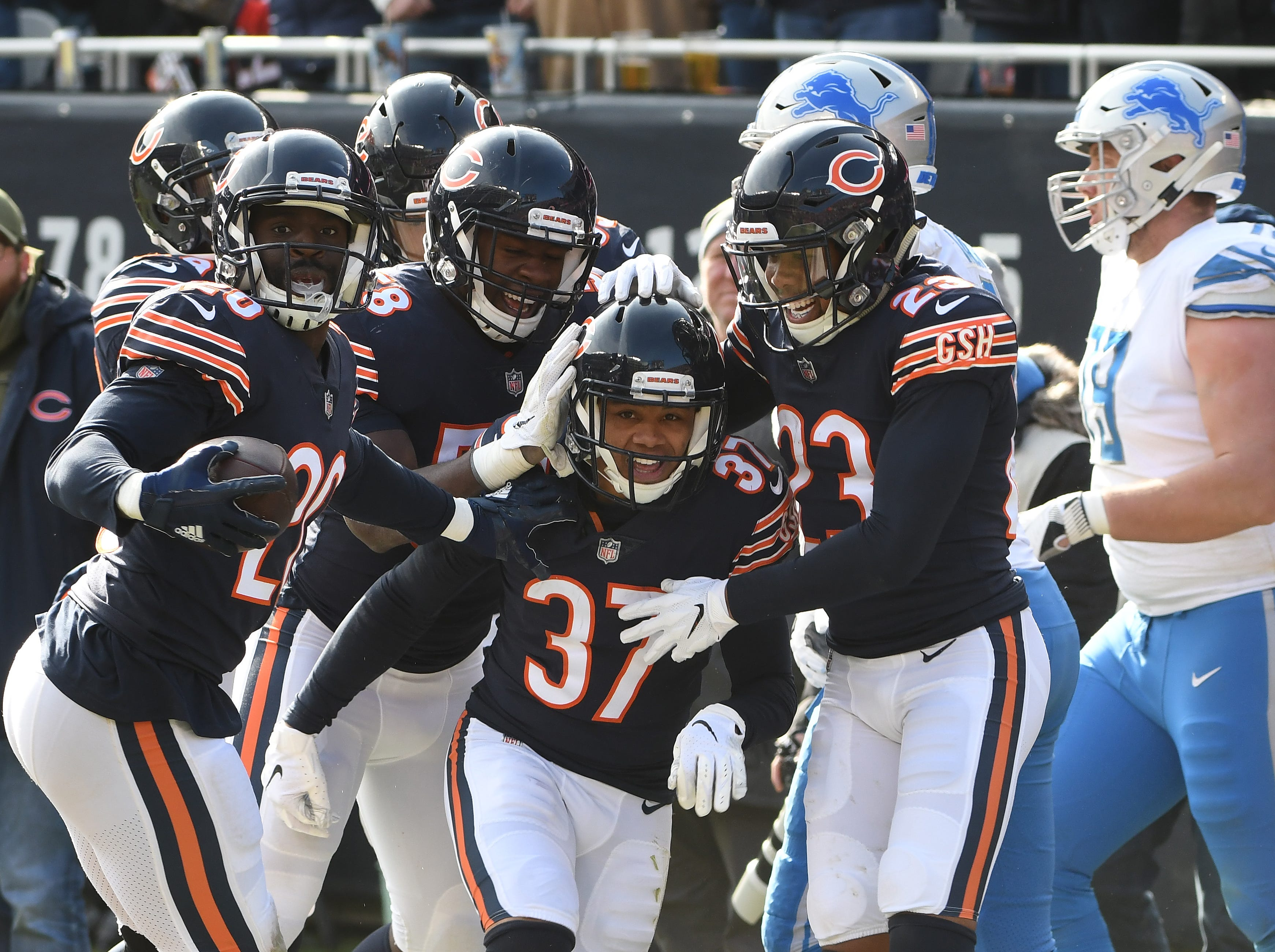 Bears' Bryce Callahan celebrates with teammates after his interception, intended for Marvin Jones Jr. in the second quarter.